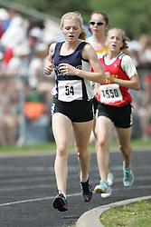 Hamilton, Ontario ---07/06/08--- Victoria Samyn of All Saints in Whitby competes in the 3000 meters at the 2008 OFSAA Track and Field meet in Hamilton, Ontario..Sean Burges