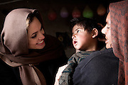 Afghanistan: UNHCR Goodwill Ambassador, Angelina Jolie, meets with  35 year old Khanum Gul, a mother of 8 and her youngest son, Samir at their makeshift home at Tamil Mill Bus site in Kabul city. <br /> <br /> When Angelina last visited Khanum Gul, Samir was a newly born baby of 14 days and he's two and a half years old, but having medical problems.<br /> <br /> Tajik and Pashtun families live side by side without any major conflict at the Tamil Mill Bus site. Over 70% of the families are returnees from the period 2002-2004 who are unable to achieve sustainable reintegration in their places of origin and subsequently drifted to Kabul City in search of work.<br /> <br /> There is a nearby school which is accessible to the children but the poor economic circumstances of the many families oblige them to send their children out to work. low levels of literacy, particularly amongst the women, limit their access to employment other than the lowest paid daily wage labour.<br /> <br /> Afghanistan/UNHCR/Jason Tanner/February 2011