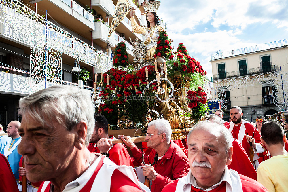 21 May 2017, San Giorgio a Cremano, Naples Italy - The &quot;Portancuollo&quot; carry on the shoulders the statue of San Giorgio Martire, the saint patron saint and protector of the city of San Giorgio in Cremano. Every year the inhabitants of San Giorgio a Cremano meets in a religious procession of thanks giving to San Giorgio Martire and Immacolata for having stopped the lava during the eruptions of Vesuvius in 1855, 1872 and the last eruption of 1944.<br /> <br /> San Giorgio a Cremano is located in the red zone instituted by Italian Government for the national evacuation plan in case of eruption of the Vesuvio.