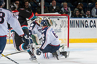KELOWNA, CANADA - OCTOBER 21: Calvin Thurkauf #27 of the Kelowna Rockets scores a goal on Nicholas Sanders #30 of the Tri-City Americans on October 21, 2016 at Prospera Place in Kelowna, British Columbia, Canada.  (Photo by Marissa Baecker/Shoot the Breeze)  *** Local Caption *** Calvin Thurkauf; Nicholas Sanders;
