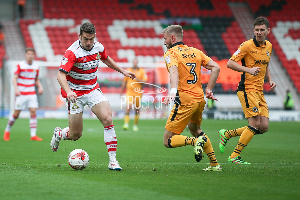 Doncaster Rovers midfielder Tommy Rowe (10)  takes on Newport County  defender Dan Butler (3)  during the EFL Sky Bet League 2 match between Doncaster Rovers and Newport County at the Keepmoat Stadium, Doncaster, England on 17 September 2016. Photo by Simon Davies.