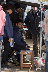© Licensed to London News Pictures. 27/03/2015. Director Maneesh Sharma during filming for the new Bollywood production 'FAN' starring Shah Rukh Khan (not pictured), at Blenheim Palace in Woodstock, Oxfordshire, UK on March 27, 2015. Shah Rukh Khan (Also known as SRK) has appeared in more than 80 Bollywood films and is considered to be one of the worlds biggest film and television stars. Photo credit: Mark Hemsworth/LNP