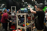 March 13, 2015 - New York, NY. Patrick Murphy, a senior at Xaverian High School in Bay Ridge, Brooklyn, readies his team's robot on day one of the FIRST Robotics Annual Regional Competition. 03/13/2015 Photograph by Allegra Abramo