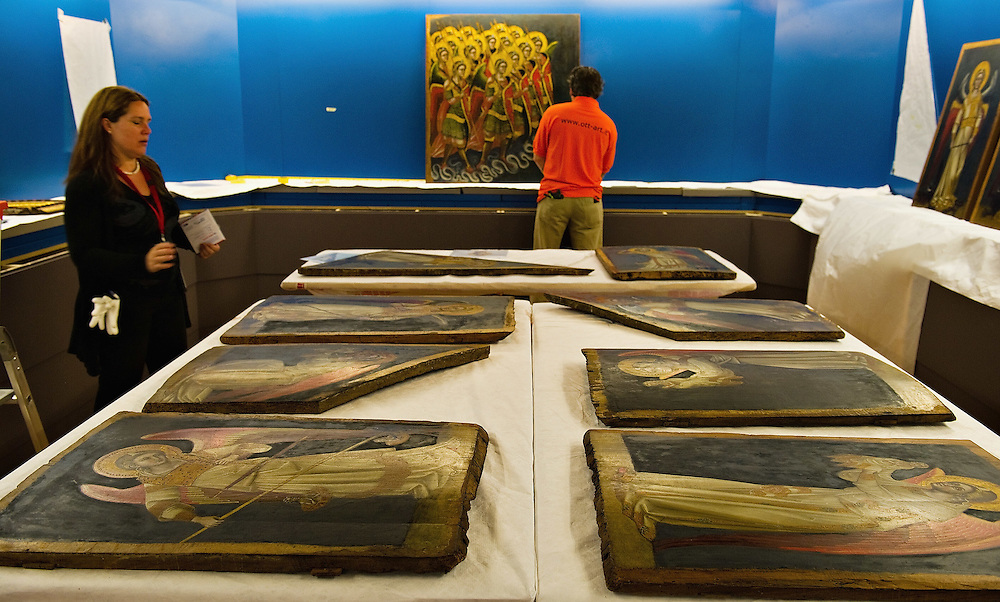 PADOVA, ITALY - APRIL 13:  A curator ad a technician check several paintings  by Guariento which will be on display on April 13, 2011 in Padova, Italy. The Guariento exhibition will be open from April 16th until July 31st in the renovated Foundation Cariparo in Piazza del Duomo.