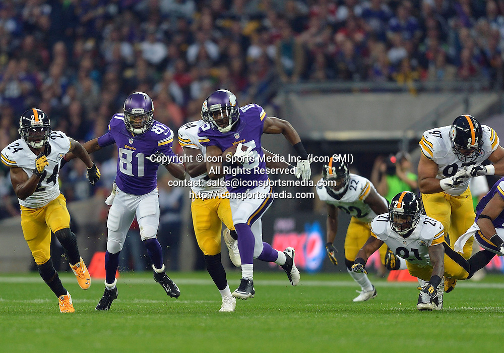 September 29, 2013:   Minnesota Vikings Wide Receiver Greg Jennings [15] on a run to a touchdown during the NFL International Series game between Pittsburgh Steelers v Minnesota Vikings at Wembley Stadium in London, England, UK.