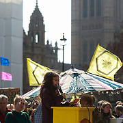 Parliament Square, ten year old Elsie Luna speaks to the crowd. For up to ten days Extinction Rebellion activists occupied Waterloo Bridge, Parliament Square, Oxford Circus and Marble Arch disrupting traffic and 'normal life'. More than a thousand people were arrested before the police finally cleared the street and the International Rebellion was called to halt by the activists.  The environmental protest group Extinction Rebellion has called for civil disobedience and peaceful protest to force the British government to take drastic action on climate change. The group wants the government to tell the truth and admit that the impact of climate change is much more severe than they say and that action to mitigate catastrophic climate change is urgent.