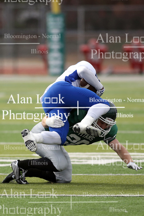 15 November 2014:  Zach Till (DB) gets a body block on M. Hawkins sending Hawkins head over heels during an NCAA division 3 football game between the North Park Vikingsand the Illinois Wesleyan Titans in Tucci Stadium on Wilder Field, Bloomington IL