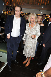 TOM PARKER BOWLES and his mother HRH The DUCHESS OF CORNWALL at the launch of Tom Parker Bowles's new book 'Full English' held in the Gallery Restaurant, Selfridges, Oxford Street, London on 9th September 2009.
