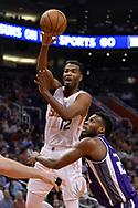 Mar 15, 2017; Phoenix, AZ, USA; Phoenix Suns forward TJ Warren (12) makes a pass over Sacramento Kings guard Buddy Hield (24) in the first half at Talking Stick Resort Arena. Mandatory Credit: Jennifer Stewart-USA TODAY Sports