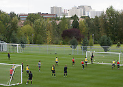 The Gonzaga Men's Soccer team warms up on the practice field at Gonzaga University. (Photo by Rajah Bose)