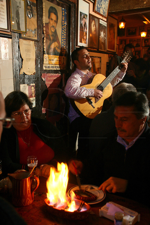 """Andre Gomes performing at """"Tasca do Chico"""". This one of the typical spots were to see live perfomances of Fado music and were the audience can spontaneously participate and also ask to sing. It is located in  Bairro Alto neighborhood"""