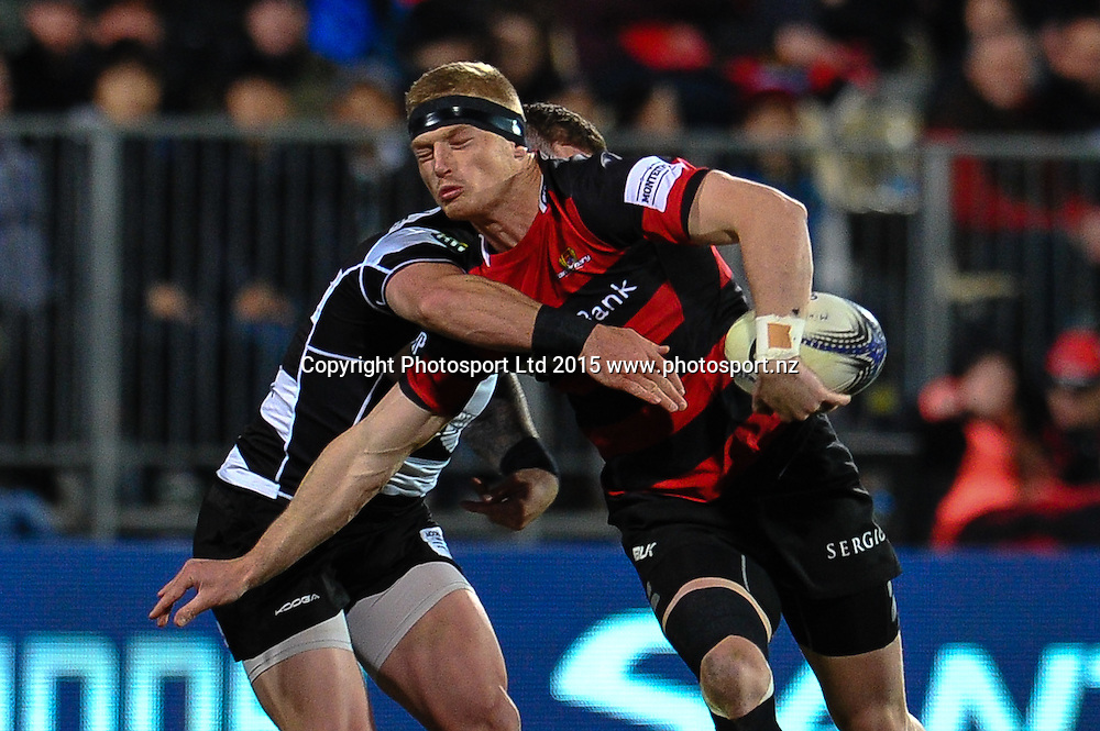 Johnny McNicholl of Canterbury is tackled by Chris Eaton of Hawkes Bay  during the ITM Cup rugby match, Canterbury v Hawke's Bay, at AMI Stadium, Christchurch, on the 12th September 2015. Copyright Photo: John Davidson / www.photosport.nz