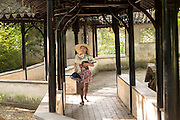 A young Chinese woman in the Humble Administrator's garden in Suzhou, China.