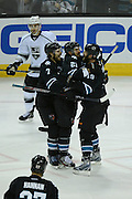May 26, 2013; San Jose, CA, USA; San Jose Sharks left wing T.J. Galiardi (21) is congratulated by defenseman Brad Stuart (7) and center Joe Thornton (19) for scoring a goal as Los Angeles Kings left wing Dustin Penner (25) looks on during the second period in game six of the second round of the 2013 Stanley Cup Playoffs at HP Pavilion.