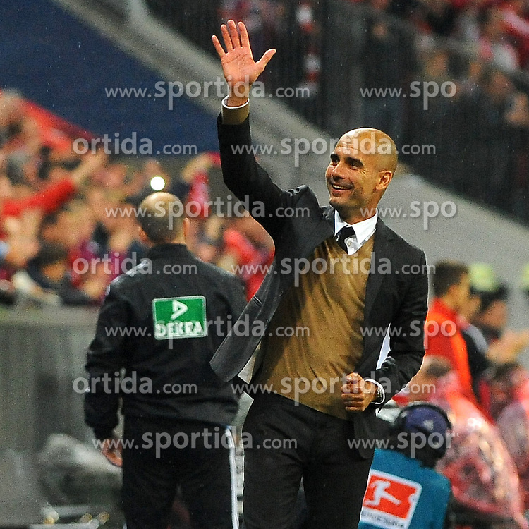 22.09.2015, Allianz Arena, Muenchen, GER, 1. FBL, FC Bayern Muenchen vs VfL Wolfsburg, 6. Runde, im Bild Trainer Pep Guardiola (FC Bayern Muenchen) winkt zu seiner Familie auf der Tribuene. // during the German Bundesliga 6th round match between FC Bayern Munich and VfL Wolfsburg at the Allianz Arena in Muenchen, Germany on 2015/09/22. EXPA Pictures &copy; 2015, PhotoCredit: EXPA/ Eibner-Pressefoto/ Stuetzle<br /> <br /> *****ATTENTION - OUT of GER*****