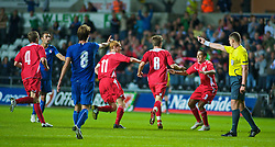 SWANSEA, ENGLAND - Friday, September 4, 2009: Wales' Aaron Ramseycelebrates scoring the winning goal to seal a 2-1 victory over Italy with team-mates captain Shaun MacDonald and Neil Taylor during the UEFA Under 21 Championship Qualifying Group 3 match at the Liberty Stadium. (Photo by Gareth Davies/Propaganda)