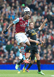 BIRMINGHAM, ENGLAND - Easter Sunday, March 31, 2013: Liverpool's Jordan Henderson in action against Aston Villa's Christian Benteke during the Premiership match at Villa Park. (Pic by David Rawcliffe/Propaganda)
