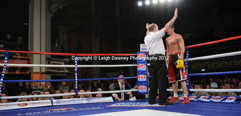 Referee Phil Edwards stops the fight in favour of Jason Ball against defeats in a 10x3 min Light Middleweight contest at Olympia, Liverpool on the 20th January 2012. Vaughan Boxing Promotions. © Leigh Dawney Photography 2012.