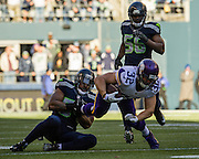 Minnesota Vikings running back, Toby Gerhart is stopped by the Seattle defense. Seattle beat the Vikings 41-20. Photo by John Lill.