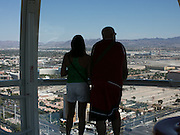 Visitors aboard the High Roller, a 550-foot observation wheel at the Linq Hotel and Casino in Las Vegas, Nevada on Monday, June 8, 2015.