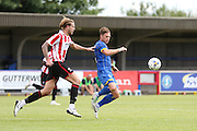Dannie Bulman in action during the Pre-Season Friendly match between AFC Wimbledon and Cheltenham Town at the Cherry Red Records Stadium, Kingston, England on 1 August 2015. Photo by Stuart Butcher.