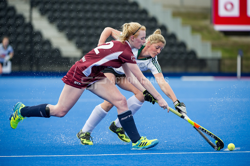 Wimbledon's Catherine Ledesma is tackled by Zoe Shipperley of Buckingham. Wimbledon v Buckingham - Investec Women's Hockey League Finals, Lee Valley Hockey & Tennis Centre, London, UK on 23 April 2017. Photo: Simon Parker