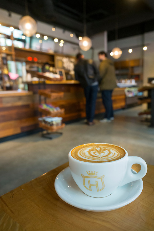 United States, Washington, Bellevue, cup of latte in coffee shop