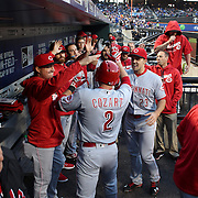 NEW YORK, NEW YORK - APRIL 27:  Zack Cozart #2 of the Cincinnati Reds is congratulated by team mates in the dugout after hitting a home run off Matt Harvey during the New York Mets Vs Cincinnati Reds MLB regular season game at Citi Field on April 27, 2016 in New York City. (Photo by Tim Clayton/Corbis via Getty Images)