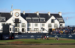 South Africa's Louis Oosthuizen takes his ball out of the hole on the 18th during day two of The Open Championship 2018 at Carnoustie Golf Links, Angus.
