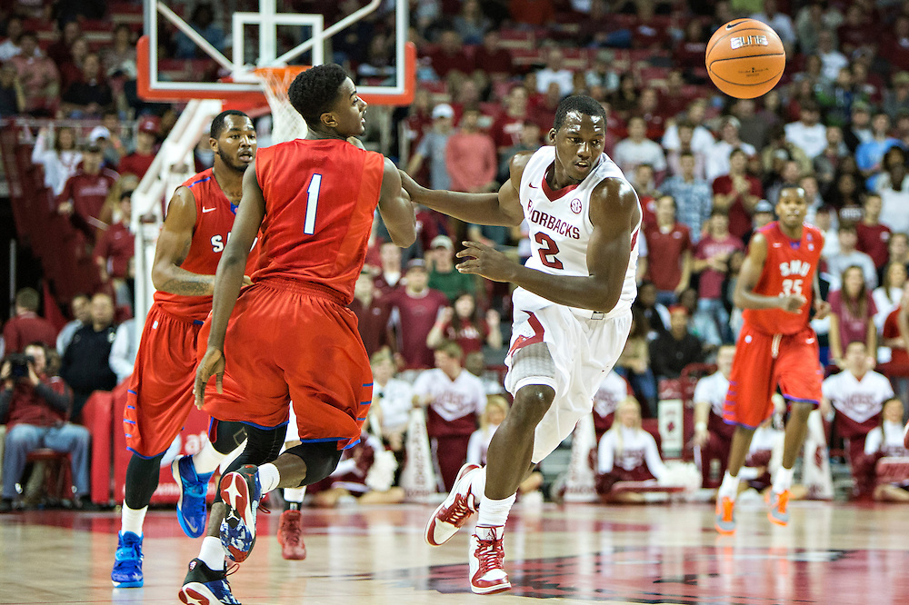 FAYETTEVILLE, AR - NOVEMBER 18:  Alandise Harris #2 of the Arkansas Razorbacks goes after a loose ball against the SMU Mustangs at Bud Walton Arena on November 18, 2013 in Fayetteville, Arkansas.  The Razorbacks defeated the Mustangs 89-78.  (Photo by Wesley Hitt/Getty Images) *** Local Caption *** Alandise Harris