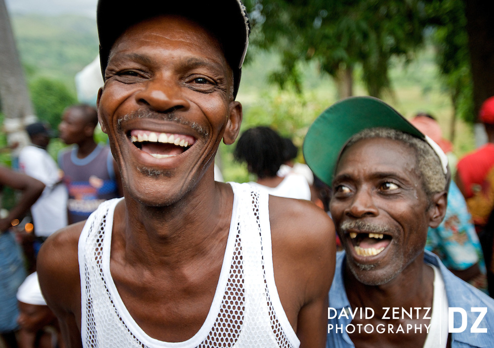 Two pilgrims laugh during the festivities surrounding the Saut D'eau voodoo pilgrimage in the nearby village of Ville Bonheur on July 16, 2008. Pilgrims travel from across the country and abroad to come to the annual festival held each July.