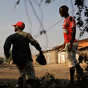 Demonstrators in Musaga, a district in Burundi's capital Bujumbura that has been at the heart of violent protests against the presidents third term bid, react to sustained automatic fire allegedly fired by police forces.