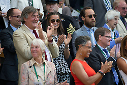 @ London News Pictures. 09/07/2015.<br /> From left to right Stephen Fry, Pippa Middleton and brother James celebrate  Serena Williams beat Maria Sharpova in the semi finals of the Ladies Wimbledon Tennis Championships today. Photo credit:LNP