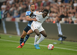 Bafetibis Gomis of Swansea City battles for the ball with Nacer Chadli of Tottenham Hotspur - Mandatory byline: Alex James/JMP - 07966 386802 - 04/10/2015 - FOOTBALL - Liberty stadium - Swansea, England - Swansea City  v Tottenham hotspur - Barclays Premier League