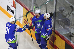 Andrej Hebar of Slovenia, Luka Basic of Slovenia and Jan Drozg of Slovenia celebrates after Jan Drozg of Slovenia scored first goal for Slovenia during Ice Hockey match between National Teams of Slovenia and Poland in Round #2 of 2018 IIHF Ice Hockey World Championship Division I Group A, on April 23, 2018 in Budapest, Hungary. Photo by David Balogh / Sportida