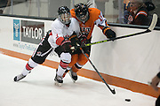 RIT's Kolbee McCrea chases a puck behind the opposing net during an exhibition game at RIT's Gene Polisseni Center on Monday, September 29, 2014.