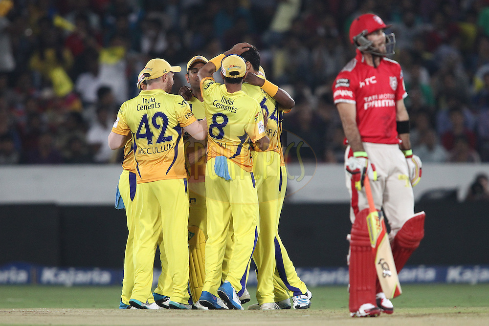 Chennai Super Kings captain MS Dhoni and Ashish Nehra of the Chennai Super Kings are congratulated for getting Glenn Maxwell of the Kings XI Punjab wicket during the second semi final match of the Oppo Champions League Twenty20 between the Kings XI Punjab and the Chennai Superkings held at the Rajiv Gandhi Cricket Stadium, Hyderabad, India on the 2nd October 2014<br /> <br /> Photo by:  Shaun Roy / Sportzpics/ CLT20<br /> <br /> <br /> Image use is subject to the terms and conditions as laid out by the BCCI/ CLT20.  The terms and conditions can be downloaded here:<br /> <br /> http://sportzpics.photoshelter.com/gallery/CLT20-Image-Terms-and-Conditions-2014/G0000IfNJn535VPU/C0000QhhKadWcjYs