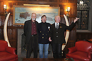 Explorers Club members Carl Schuster (middle), an cartographic expert, and Ross von Burg (left), an explorer who has sailed extensively and is an expert on civilian future space travel, with another member in the club's members lounge...Founded in New York City in 1904, The Explorers Club promotes the scientific exploration of land, sea, air, and space by supporting research and education in the physical, natural and biological sciences. The Club's members have been responsible for an illustrious series of famous firsts: First to the North Pole, first to the South Pole, first to the summit of Mount Everest, first to the deepest point in the ocean, first to the surface of the moon--all accomplished by our members.