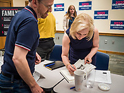"24 MAY 2019 - WEST DES MOINES, IOWA: US Senator KIRSTEN GILLIBRAND (D-NY), autographs a copy of her book for person who attended her forum in the West Des Moines Public Library. Gillibrand unveiled her ""Family Bill of Rights"" during a forum in West Des Moines. The New York Senator has made family health and rights a centerpiece of her campaign. She is touring Iowa this week to support her candidacy to be the Democratic nominee for the US Presidency. Iowa traditionally hosts the the first selection event of the presidential election cycle. The Iowa Caucuses will be on Feb. 3, 2020.           PHOTO BY JACK KURTZ"