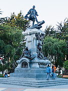 "A monument honors Ferdinand Magellan (1480-1521) in Punta Arenas, an important port city on the Strait of Magellan, in Chile, South America. Punta Arenas is the capital city of Chile's southernmost region, Magallanes and Antartica Chilena. Ferdinand Magellan (Spanish: Fernando de Magallanes, Portuguese: Fernão de Magalhães) was a Portuguese explorer who served King Charles I of Spain in search of a westward route to the ""Spice Islands"" (modern Maluku Islands in Indonesia). Magellan's expedition of 1519-1522 was the first expedition to sail from the Atlantic Ocean into and across the Pacific Ocean and first to circumnavigate the Earth. Magellan himself did not complete the entire voyage, as he was killed in the Battle of Mactan in the Philippines. The foot of South America is known as Patagonia, a name derived from coastal giants, Patagão or Patagoni, who were reported by Magellan's 1520s voyage circumnavigating the world and were actually Tehuelche native people who averaged 25 cm (or 10 inches) taller than the Spaniards."