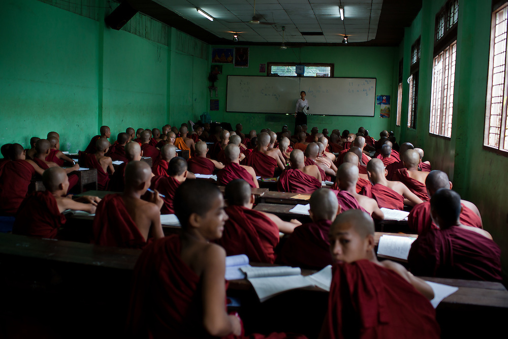 Large classes of monks receive part of their instruction from lay teachers.