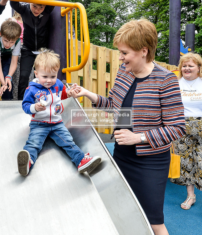Pictured: Nicola Sturgeon meets Jamie McGuinness (2) on one of the slides.<br /> <br /> First Minister Nicola Sturgeon opened Scotland's largest 'inclusive' play park at Pittencrief Park in Dunfermline.<br /> <br /> © Dave Johnston/ EEm