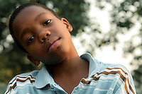 Young man who wanted his picture taken, in Oakland, CA. Copyright 2008 Reid McNally.