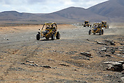 Tourists driving dune buggy vehicles, Fuerteventura, Canary Islands, Spain