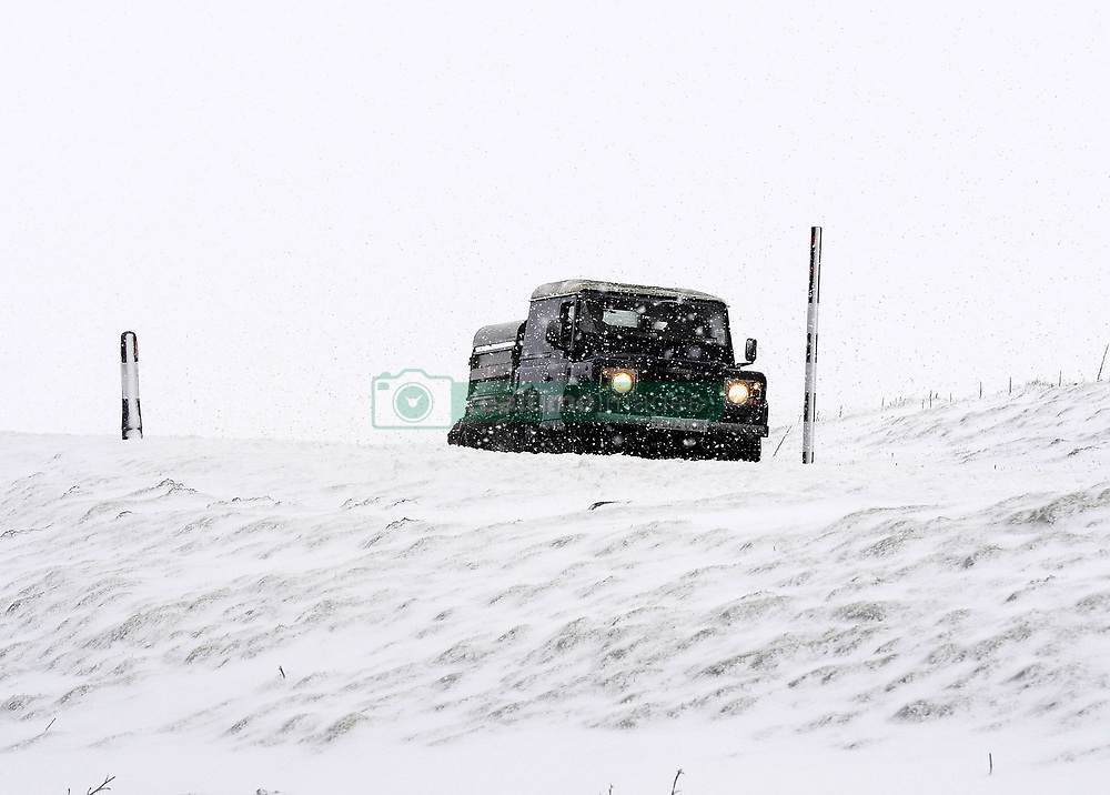 A vehicle navigates the snowy road between Hawes and Swaledale in Yorkshire, as forecasters have issued a series of yellow weather warnings which affect large areas of the country.