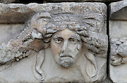 Mask and garland frieze from the Portico of Tiberius on the Southern portico of the Agora, 1st century AD, Aphrodisias, Aydin, Turkey. The Sculpture School at Aphrodisias was an important producer of carved marble sarcophagi and friezes from the 1st century BC until the 6th century AD. The Portico of Tiberius was built under the reign of Tiberius and has many examples of mask and garland friezes, consisting of the heads of gods, goddesses, theatrical characters, mythological figures or masks, each with a distinct facial expression, between hanging garlands of leaves, fruit and flowers. This example may represent sadness or bitterness. Aphrodisias was a small ancient Greek city in Caria near the modern-day town of Geyre. It was named after Aphrodite, the Greek goddess of love, who had here her unique cult image, the Aphrodite of Aphrodisias. The city suffered major earthquakes in the 4th and 7th centuries which destroyed most of the ancient structures. Picture by Manuel Cohen