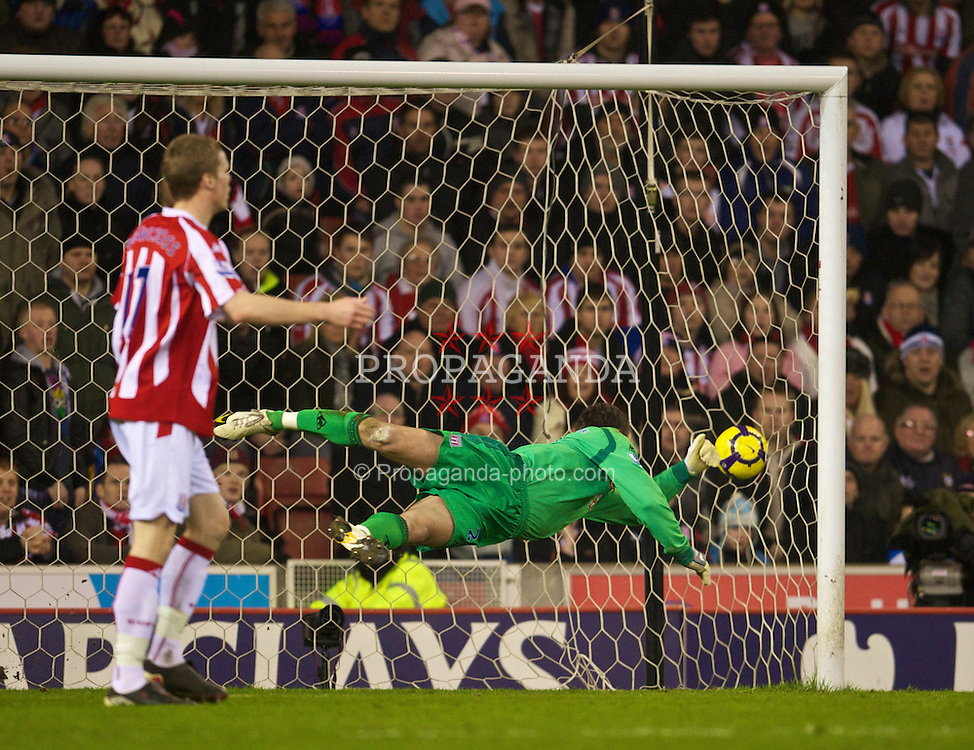 STOKE-ON-TRENT, ENGLAND - Saturday, February 27, 2010: Stoke City's goalkeeper Thomas Sorensen is beaten by Arsenal's Nicklas Bendtner for the equalising goal during the FA Premier League match at the Britannia Stadium. (Photo by David Rawcliffe/Propaganda)