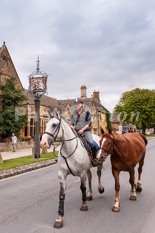 A girl riding and exercising her horses in Broadway , <br /> Worcestershire , England , Britain , Uk