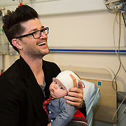25/12/2014<br /> Special visitors on Christmas Day in Temple Street Children&rsquo;s Hospital<br /> Danny from the Script makes little kid&rsquo;s Christmas with hospital visit.<br /> Pictured here are Danny with Seimi Brennan from Dublin.<br /> Danny O&rsquo;Donoghue showed a heart of gold when he turned up at Temple Street&rsquo;s Children&rsquo;s Hospital on Christmas Day. The Script&rsquo;s frontman spent a number of hours on Christmas morning visiting children at their bedside along with Santa, the Lord Mayo.&nbsp;Last year, almost 400 children were cared for in Temple Street on Christmas Eve and Christmas Day &amp; a visit from Danny helped bring the magic of Christmas to Temple Street for the children and babies who are too ill or weak to make it home. Danny said of his work with Temple Street &ldquo;It&rsquo;s amazing to be involved with Temple Street, it&rsquo;s the greatest hospital on the planet. It&rsquo;s really humbling to see the children, families, doctors and nurses in Temple Street; they are all true superheroes.&quot;<br /> Pic: Alan Rowlette Photography<br /> -ENDS-