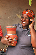 A potter uses her cell phone during a trip for a new program developing mobile technology for craft businesses by The Africa Craft Trust, Women's Net and Open Africa